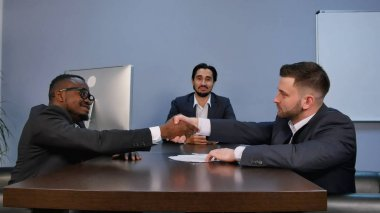 Businessman shaking hands to seal a deal with his partner during meeting