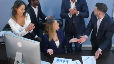 Business multiracial team applauding to each other in office