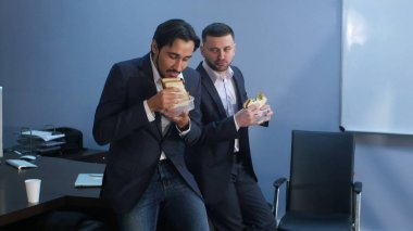Office workers have a break from work to eat second breakfast