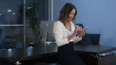 Asian businesswoman using smartphone in office