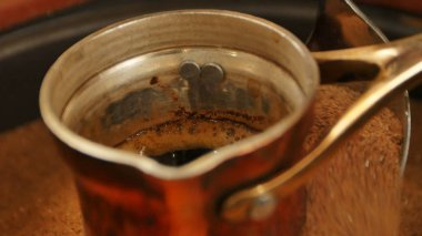 Traditional process boil Turkish coffee in turk
