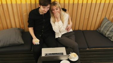 Loving couple sitting in drinking coffee enjoying time together
