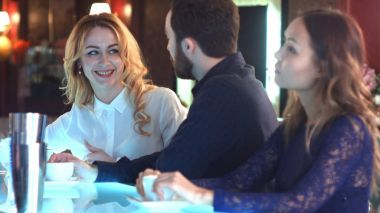 Couple laughing and having a good time in a bar