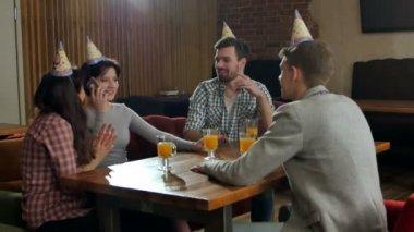 Group of friends enjoying party and celebratin birthday
