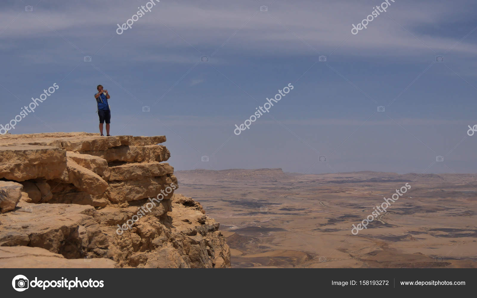 Man Standing On A Cliff