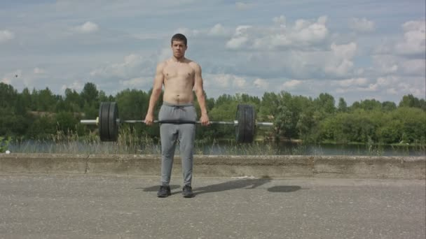 Bodybuilder doing barbell weight workout deadlift with heavy bar