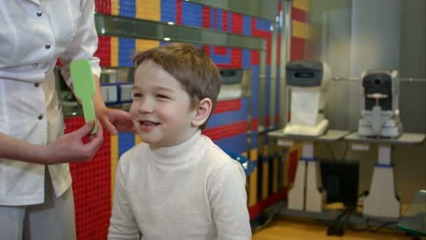 Happy child reviewing eyesight