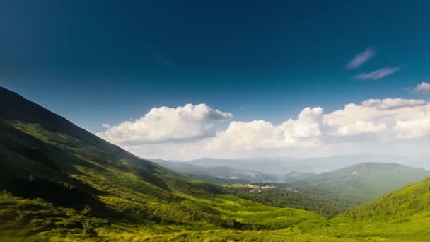 Panoramic view of idyllic summer landscape in the Alps with clear mountain lake and fresh green mountain timelapse