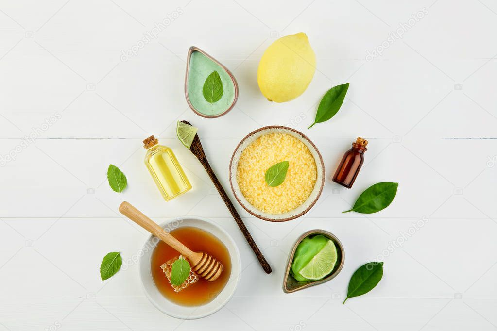 Homemade lemon essential oil, salt bath and fresh honey in the p