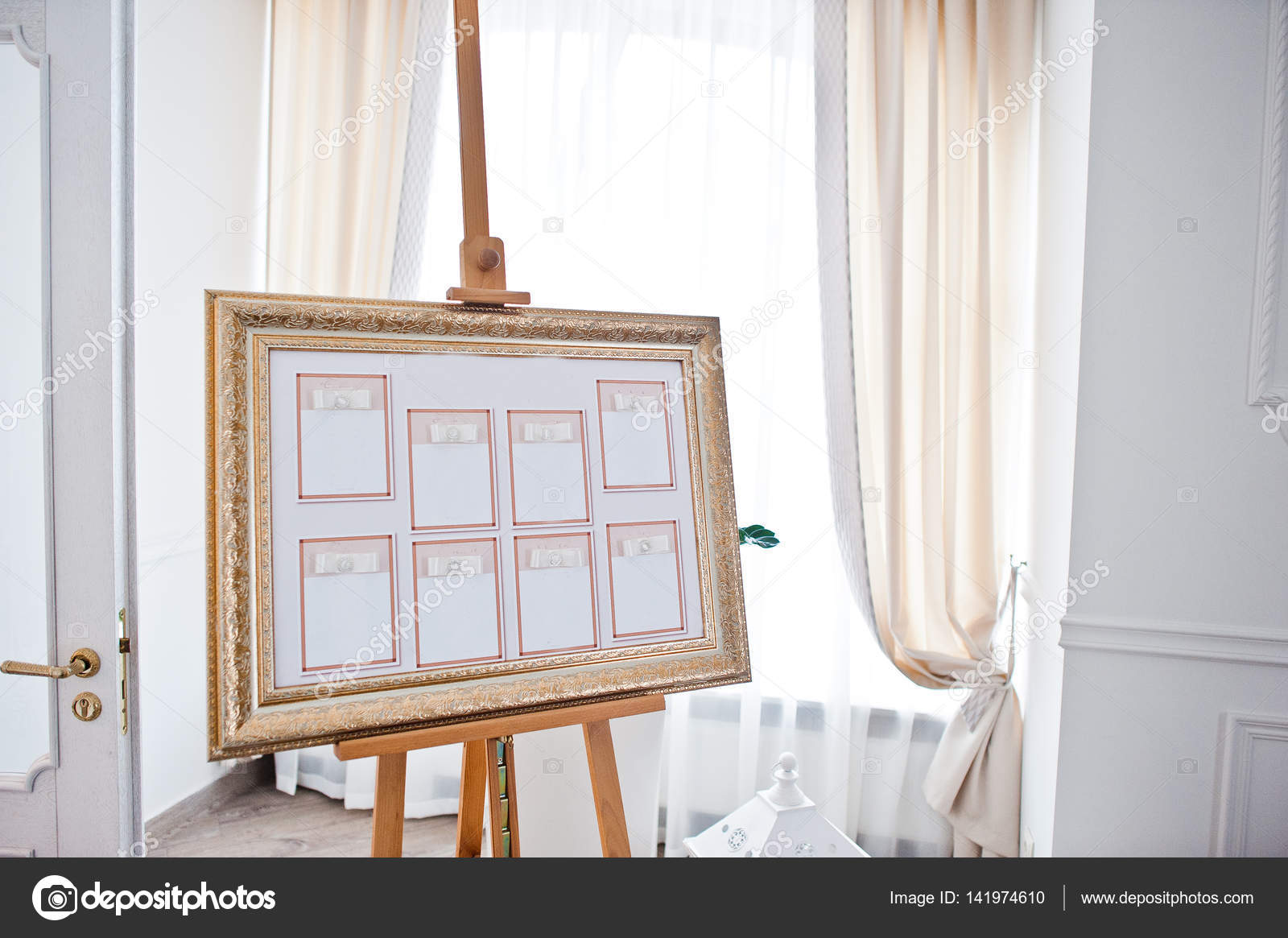 wedding seating chart on the easel at light restaurant stock