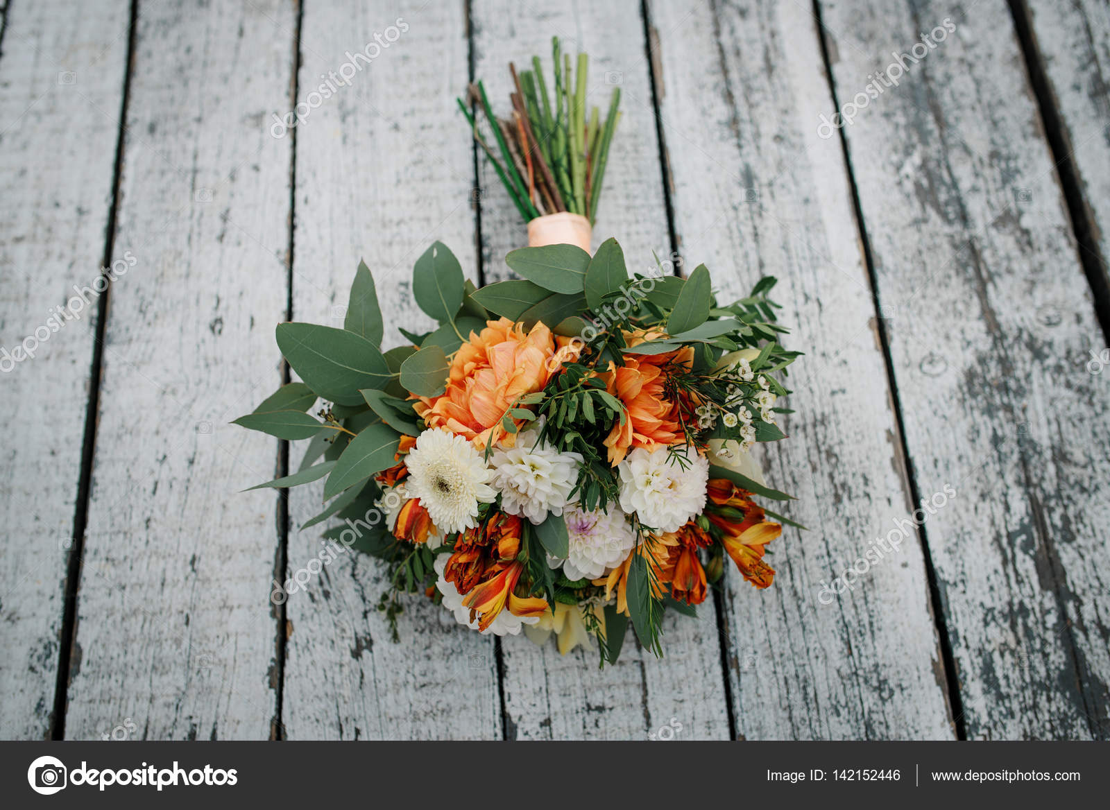 Elegant Orange And White Wedding Bouquet On Wooden Background