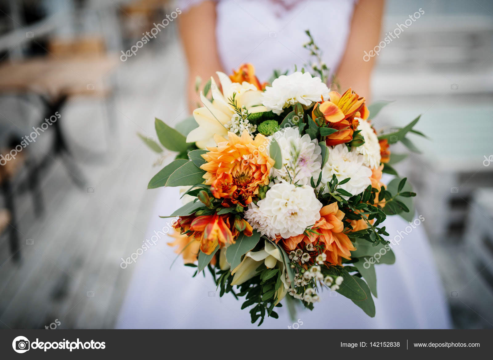 Elegant Orange And White Wedding Bouquet At Hands Of Bride Stock