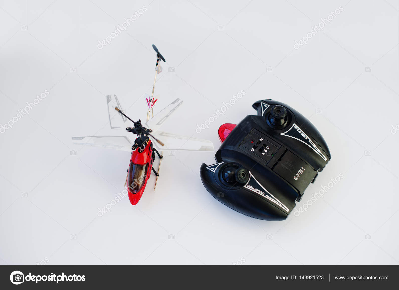 Remote control red helicopter isolated on white background