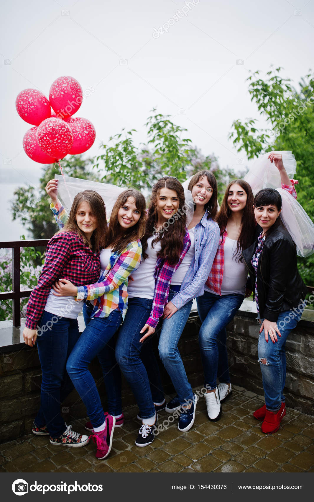 Group Of Six Girls Having Fun At Hen Party With Balloons