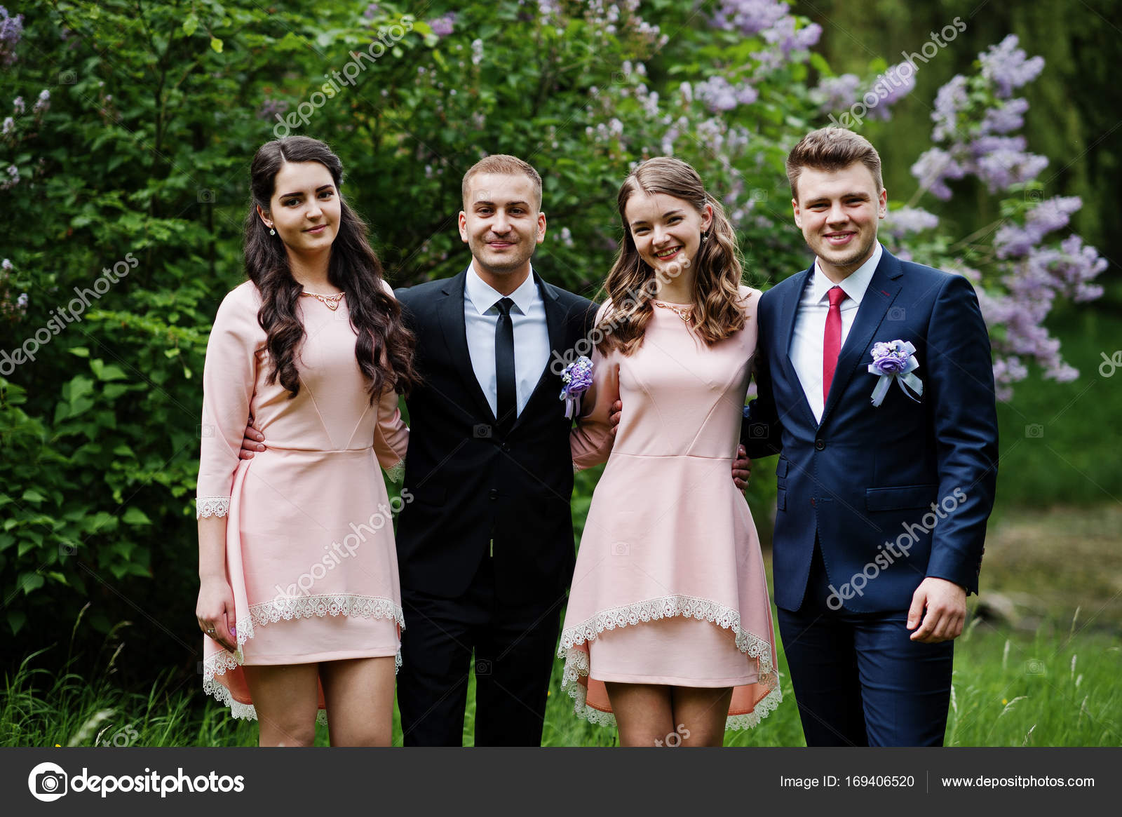 e47fc156ad6 Bridesmaids in pink dresses posing with handsome groomsmen in tu– stock  image