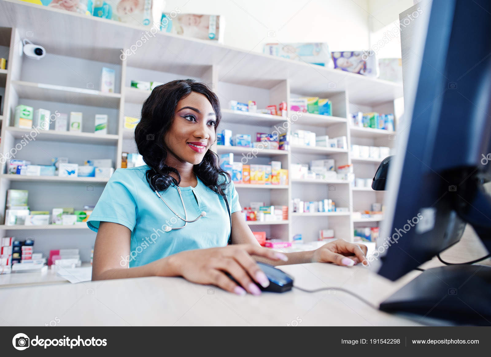 African American Pharmacist Cashier Working In Drugstore At Hosp