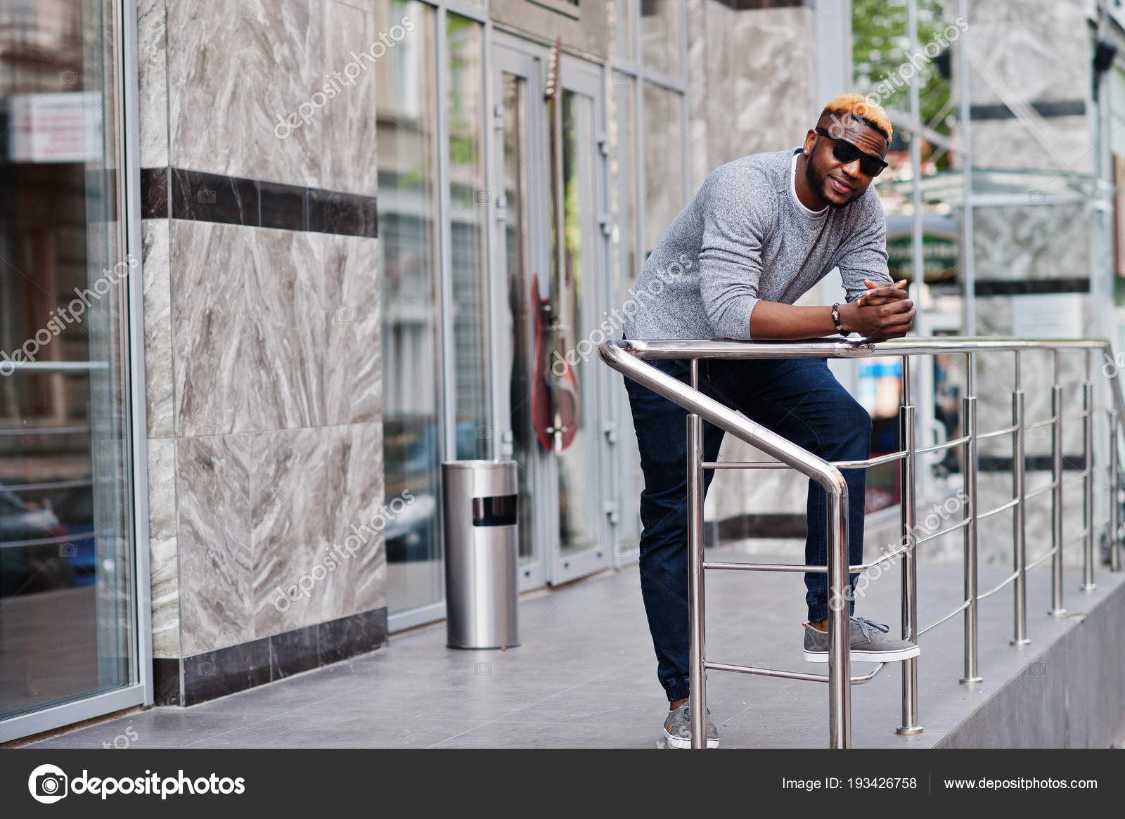 dcf8febce90 Stylish african american boy on gray sweater and black sunglasses posed at  street. Fashionable black guy. — Photo by ASphoto777