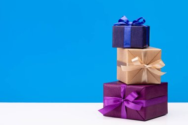 Vertical boxes with gifts in multi-colored paper for different holidays and events. Copy space.