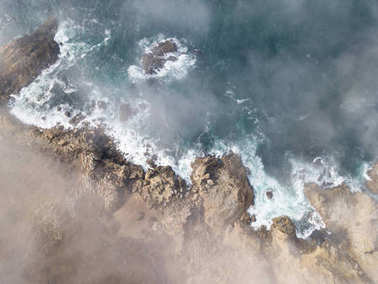 Aerial View of Mist Drifting Over California Coast