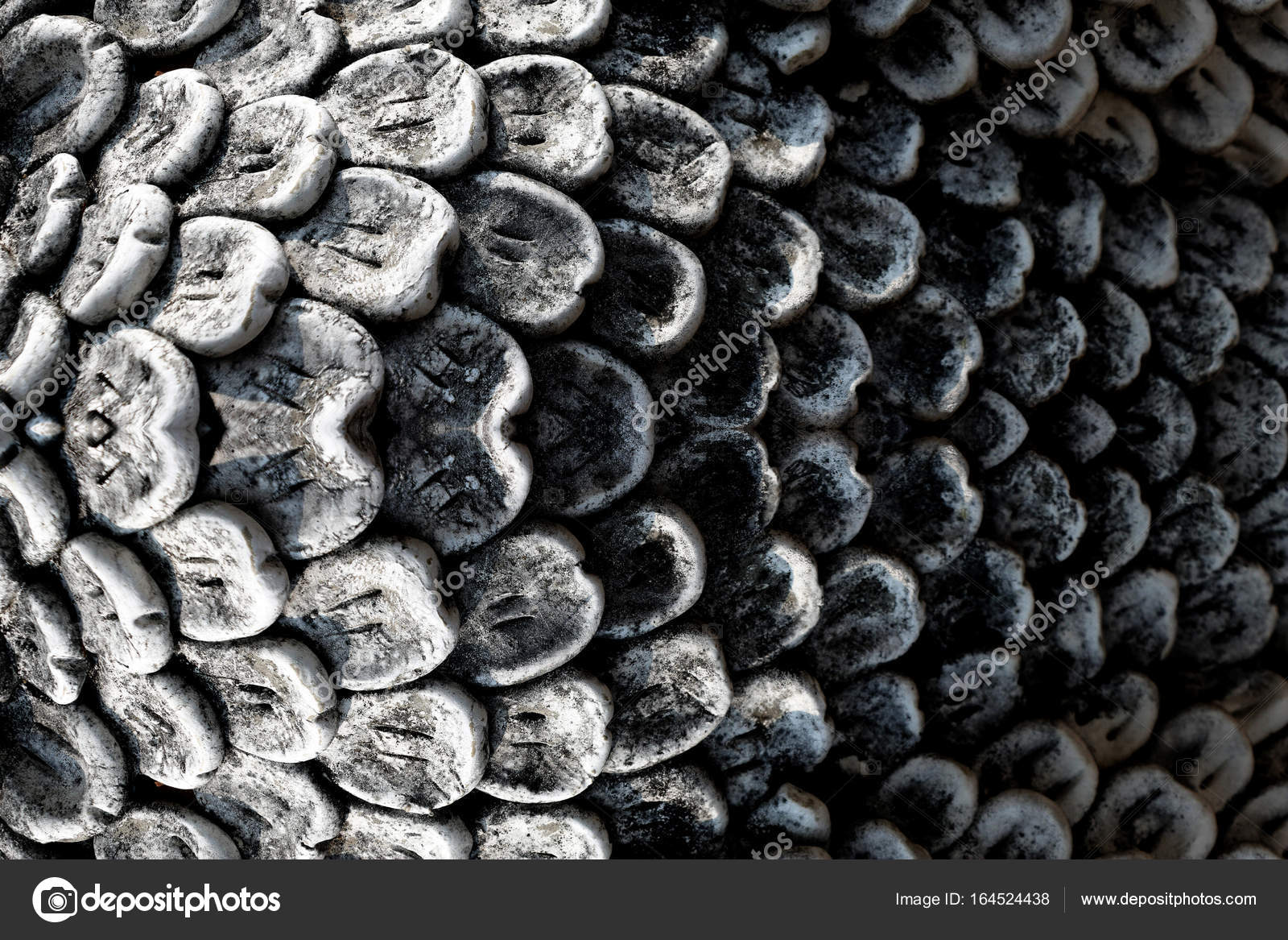 Close up of texture of sculpture fish scales stone carving