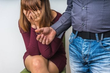 Man returning the wedding ring to his wife - divorce concept