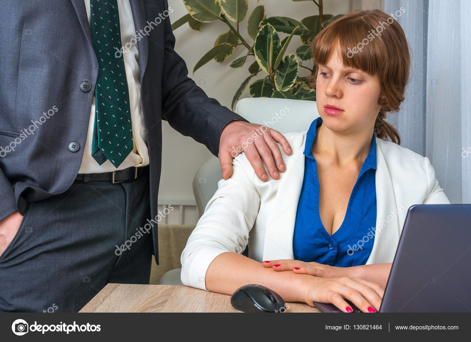 Man touching womans shoulder - sexual harassment in