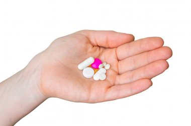Pile of pills in female hand isolated on white