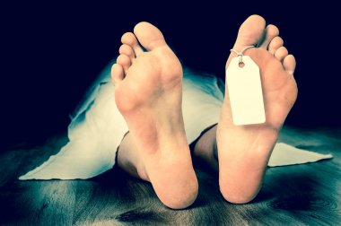 Dead woman lying on the floor under white cloth - retro style