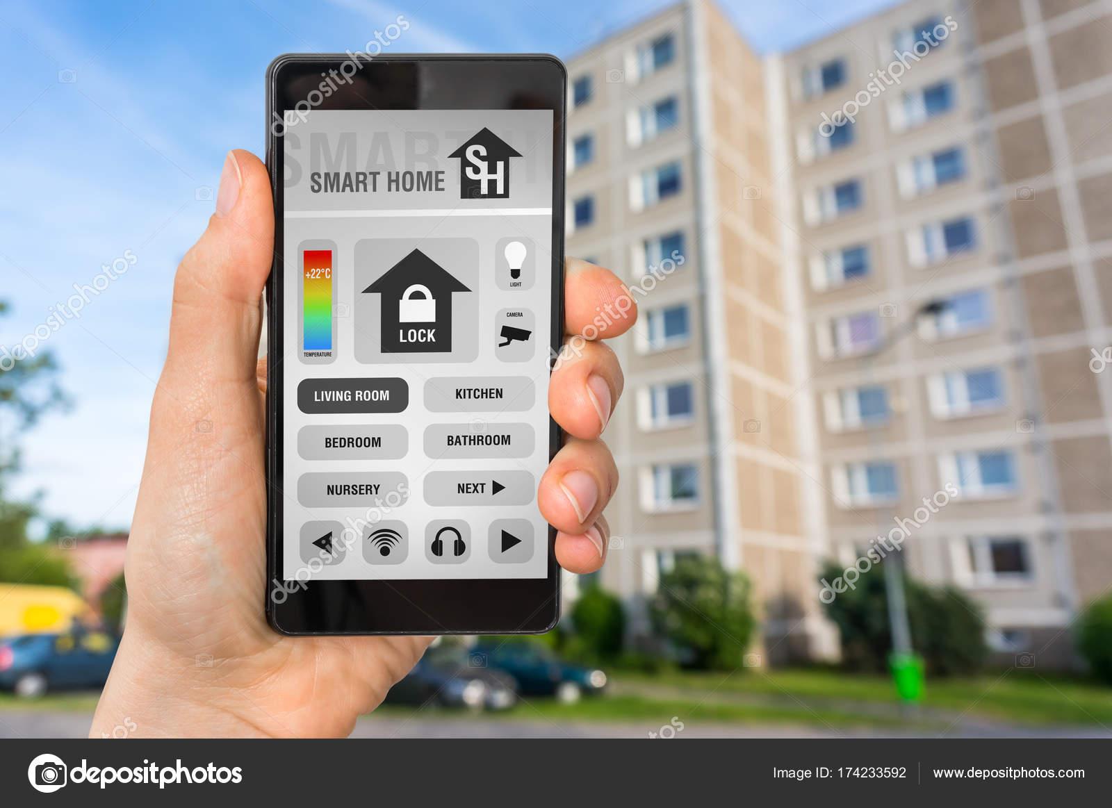 Smart home control app on smartphone - smart home concept