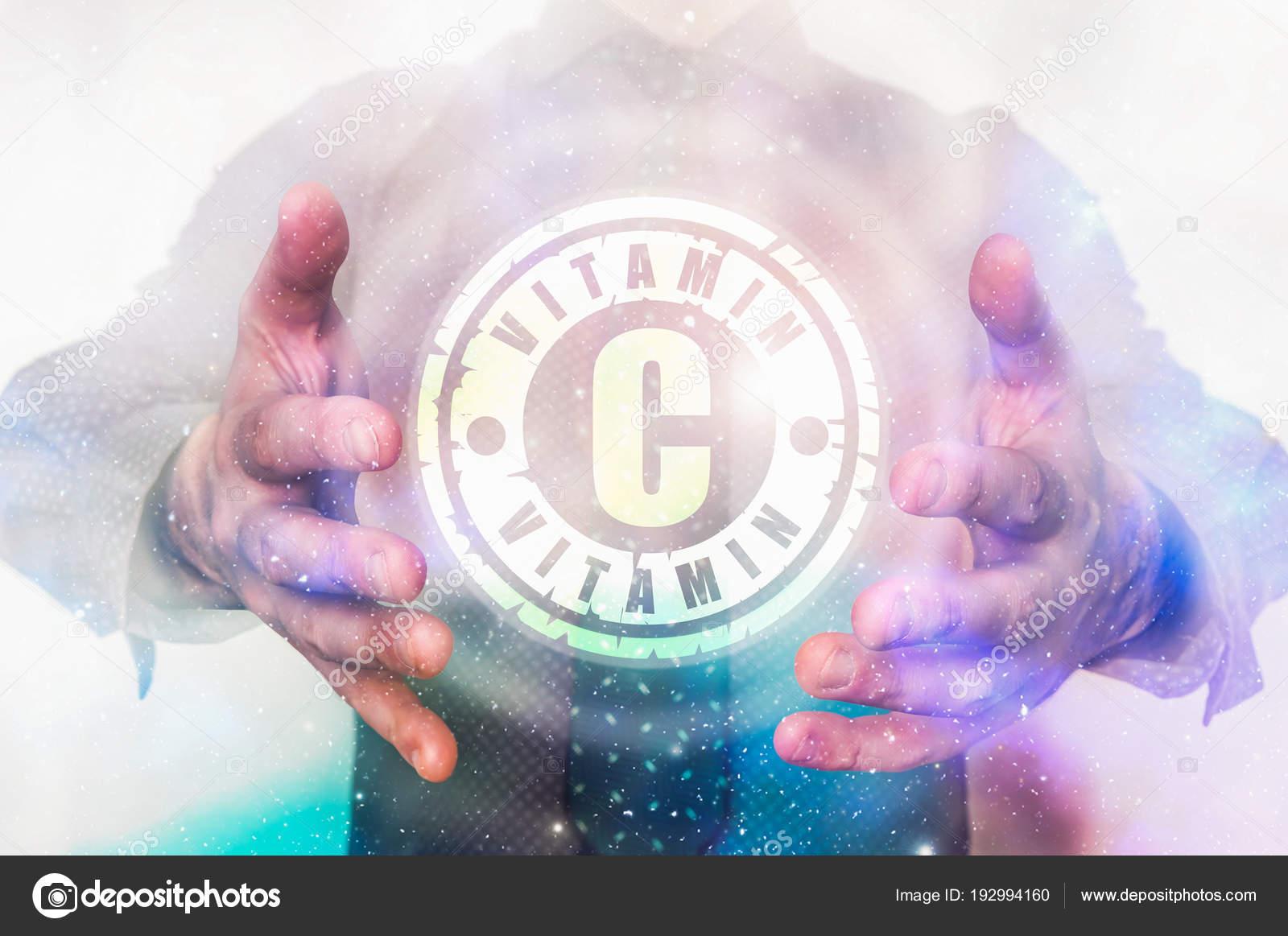Man Is Showing Vitamin C Symbol Between His Hands Stock Photo