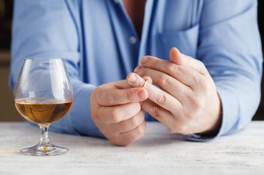Divorce concept. man taking off wedding ring stock vector