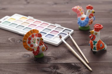 painting traditional russian Dymkovo toy