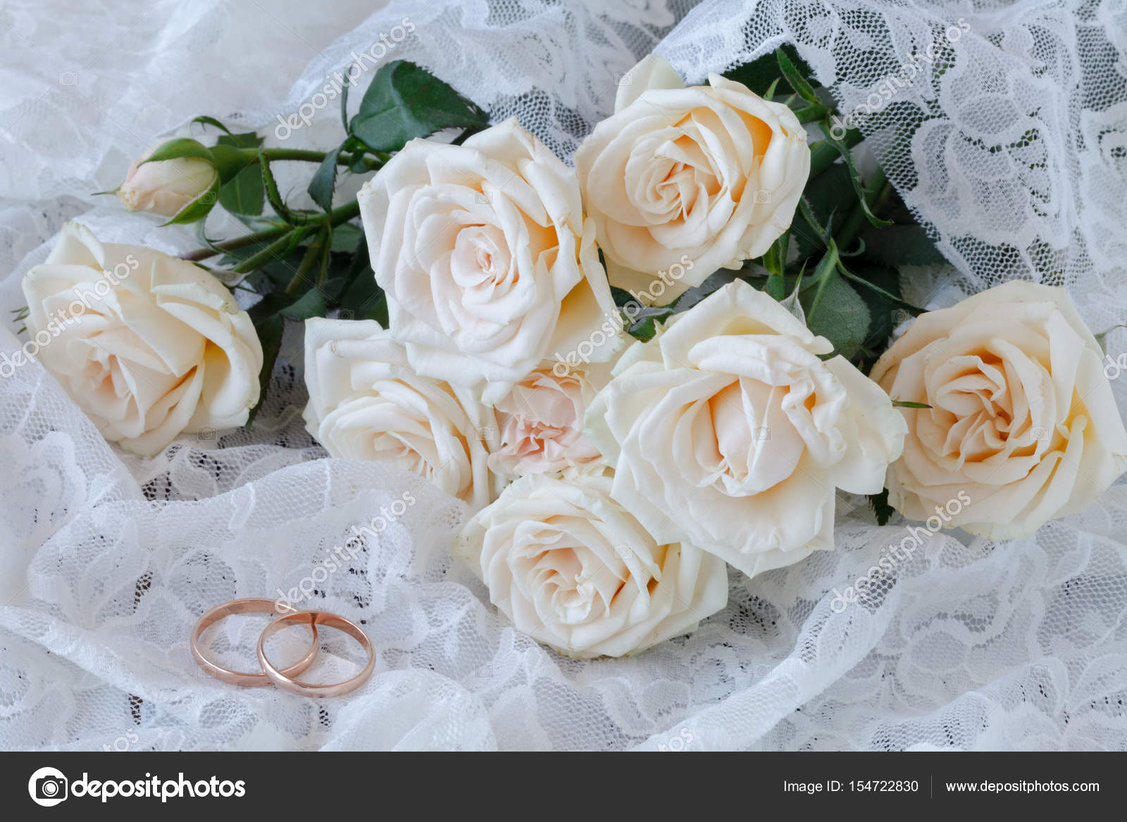 The Rings On The Flowers On A White Fabric Wedding Details Stock
