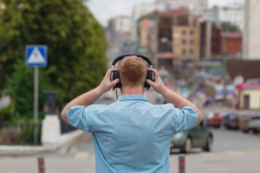 Man Walking Listening Music Earphones Concept