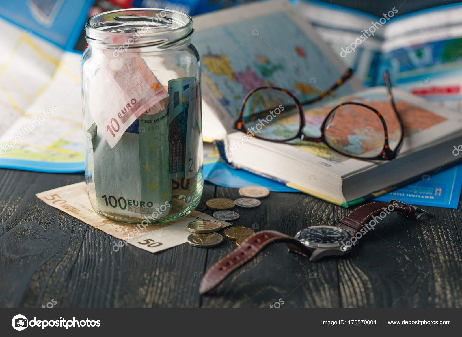 Travel budget vacation money savings in a glass jar on world m travel budget vacation money savings in a glass jar on world map photo by andreycherkasov gumiabroncs Choice Image