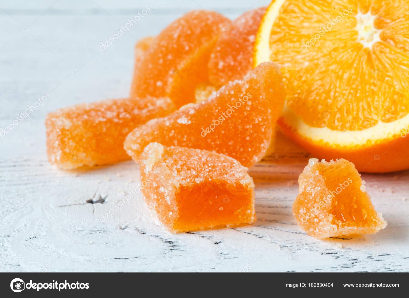 orange marmelad with slided oranges on table stock photo