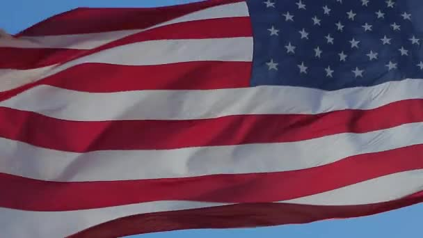 Close up of American flag waving.