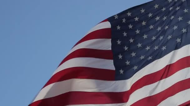 Close up of American flag waving.