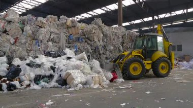 Large warehouse of waste paper in a factory.