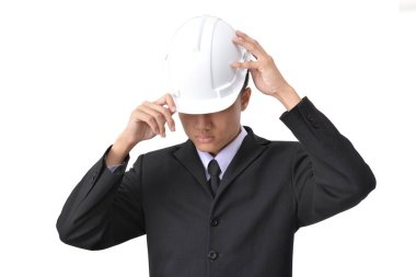 Young engineer on a white background