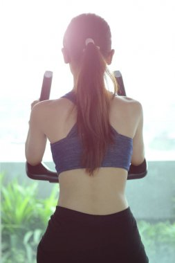 Exercise in the gym, women want to have a beautiful body with fi