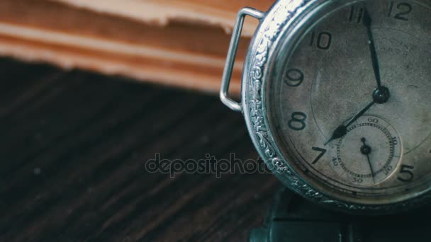 Vintage Antique pocket watch on the background of old books.
