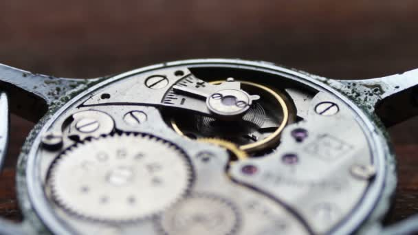 .Inside of watch mechanism On a stylish wooden background