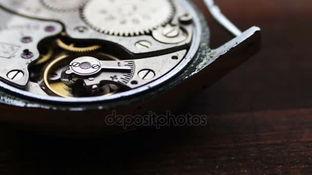 Old Stopwatch Mechanism On a stylish wooden background