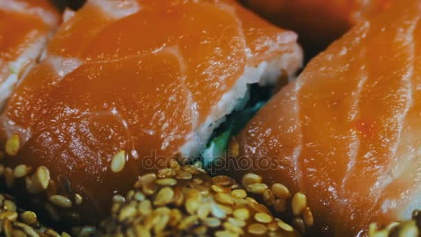 Salmon maki roll  Japanese sushi cuisine with fresh raw fish Japanese dish  consisting of rice, salmon or tuna,shrimp and fish eggs soaked in soy