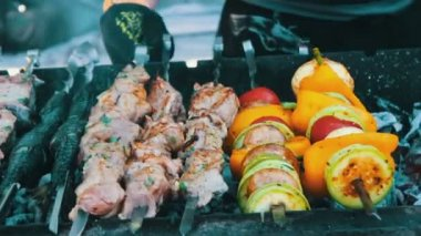 Barbecue fish, meat and vegetables roast on the grill.Street Food, Fast Food, Snack on the street, taseful, delicious