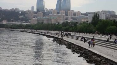 MAY 9, 2017 - AZERBAIJAN, BAKU: People are sitting and walking along the famous embankment of a Caspian Sea in Baku