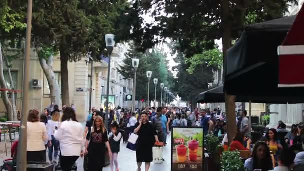 MAY 9, 2017, BAKU, AZERBAIJAN: People stroll in square of Baku, a crowd of people walk the streets of the city.