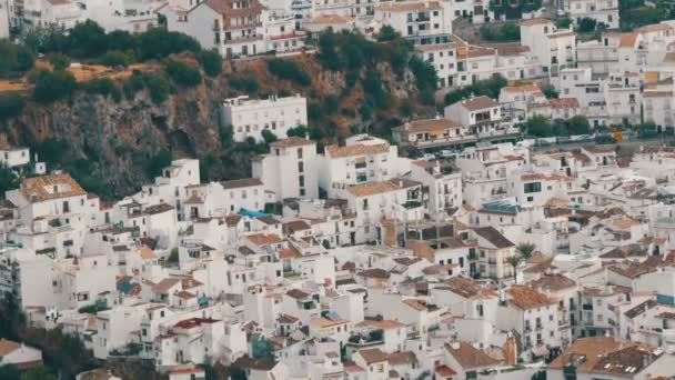 Many white houses are high in the mountains,panoramic view,Stunning beauty of the white villages of Andalusia in Spain.