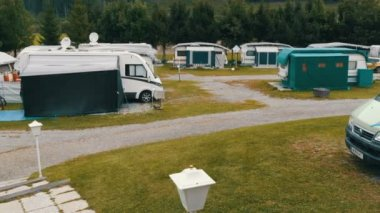September 8, 2017 - Unterterl, Austria: Parking camping in which many trailers and in which people live. Picturesque Austrian valley on which there is a campsite